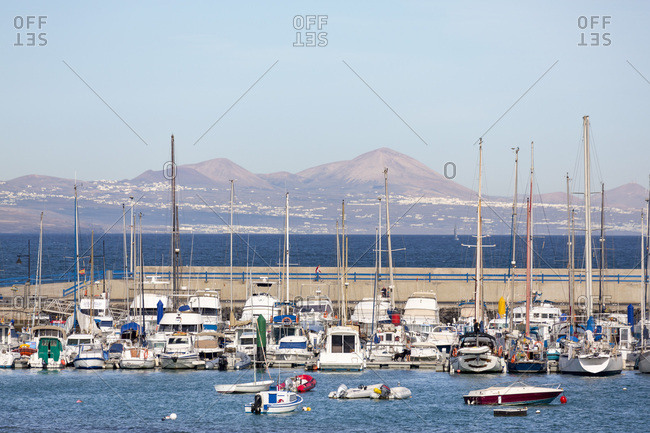 December 31, 2017: The harbor at Corralejo on the island of Fuerteventura with Lanzarote in the distance, Fuerteventura, Canary Islands, Spain, Atlantic, Europe