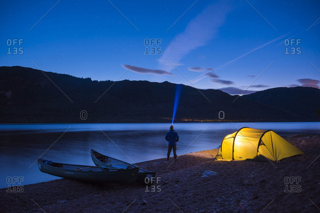 August 9, 2017: Camping at Loch Ness at night while canoeing the Caledonian Canal, Scottish Highlands, Scotland, United Kingdom, Europe