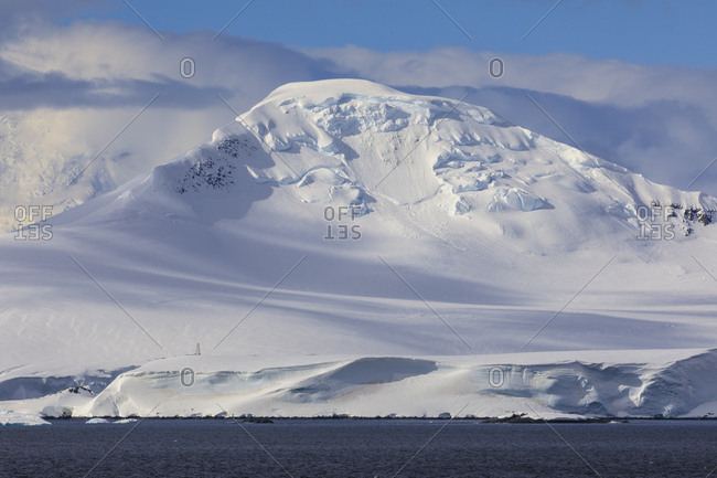 Glaciers, iceberg and misty mountains, off Cape Errera, Wiencke Island, Antarctic Peninsula, Antarctica, Polar Regions