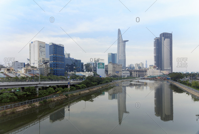 January 13, 2018: The view of the Bitexco Tower in Ho Chi Minh City (Saigon) center and a canal off the Saigon River, Vietnam, Indochina, Southeast Asia, Asia