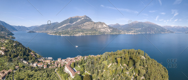 Panoramic aerial view of Bellagio on green promontory on the shore of Lake Como, Province of Como, Lombardy, Italian Lakes, Italy, Europe (Drone)