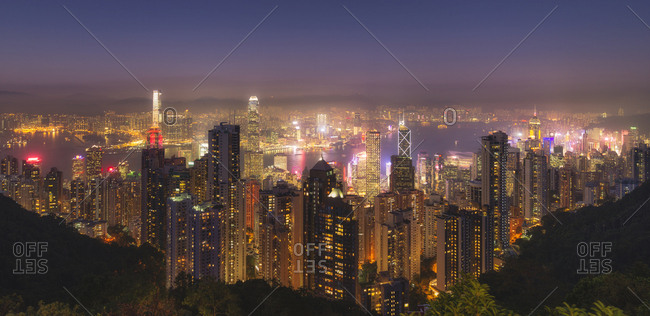 Hong Kong city skyline at night, showing the Central and Kowloon area, viewed from Victoria Peak, Hong Kong, China, Asia