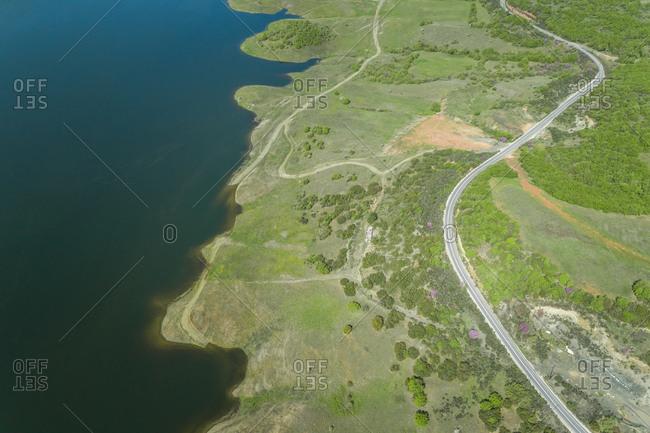 Aerial view of empty windy road beside lake Plastira in Karditsa region, Greece