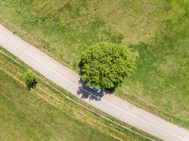 Aerial view of white car on asphalt road in the countryside, Greece