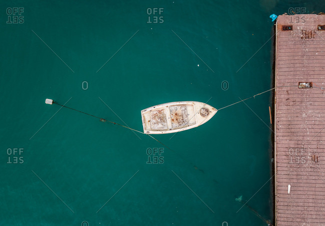 Aerial view of small boat tied to the dock in Patras, Greece