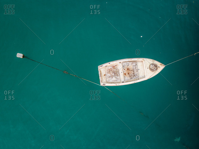 Aerial view of small boat moored next to dock in Patras, Greece