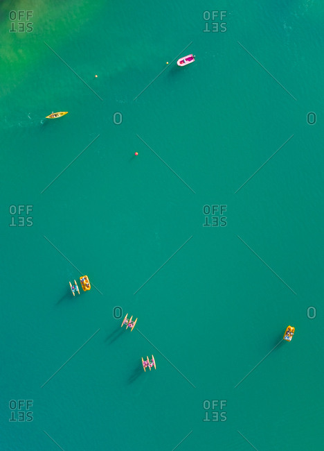 Aerial view of group of people doing recreational water sports activities at lake Plastira in Greece