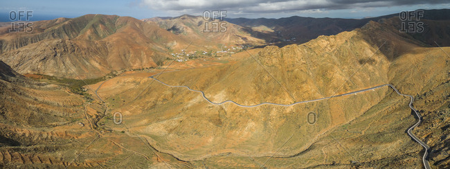 Aerial panoramic view of the famous winding mountain road that links the small towns of Casillas del Angel a in Fuerteventura, Canary Islands, Spain.