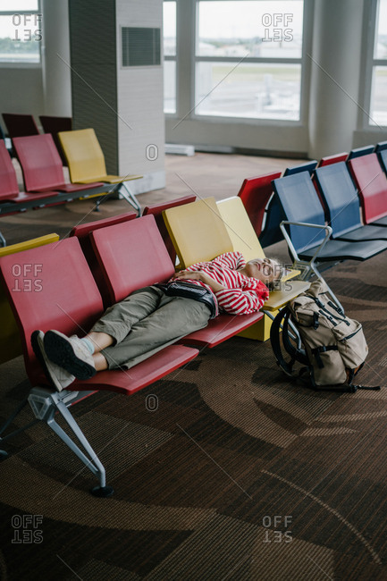 Woman sleeping on airport seats