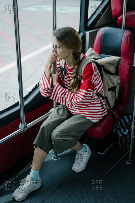 Woman riding shuttle bus at an airport