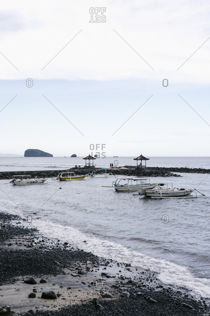 Bali, Indonesia - April 4, 2018: Traditional Indonesian boats on the coast of Bali