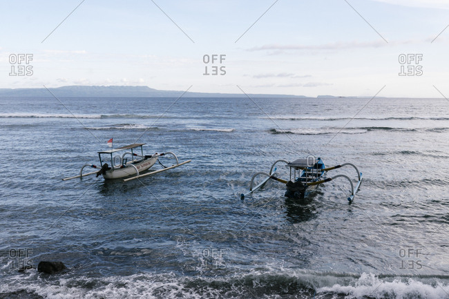 Bali, Indonesia - April 4, 2018: Traditional Indonesian canoes in the water