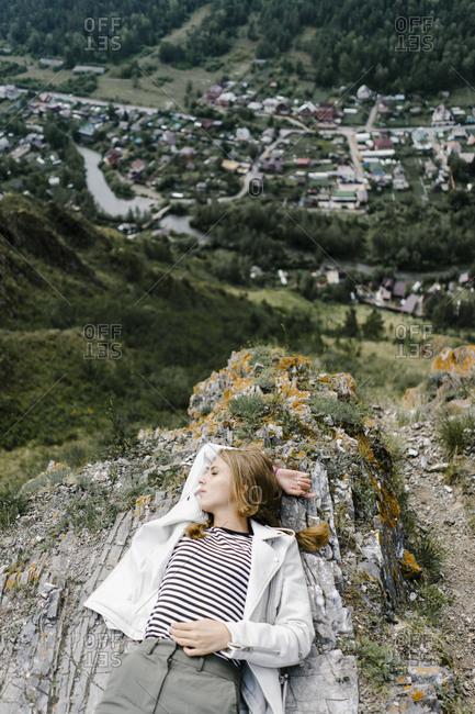 Young woman lying on a hill in Krasnoyarsk, Russia