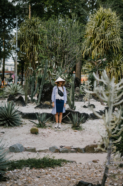 Female tourist standing across cactus garden