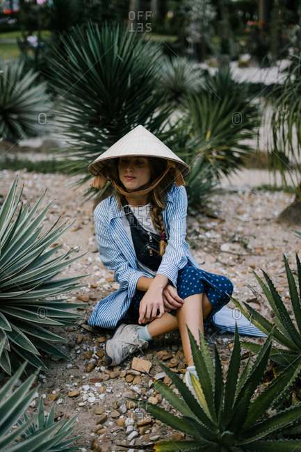 Woman relaxing in Ho Chi Minh botanical garden