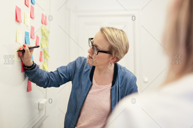 Woman in brainstorming session