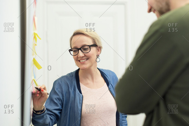 Smiling woman during brainstorming