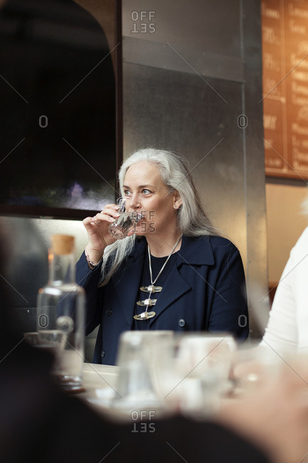 Mature woman drinking water