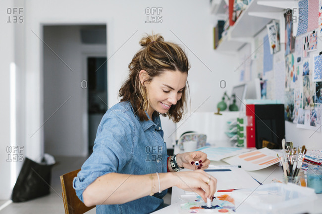 Young woman painting with watercolor