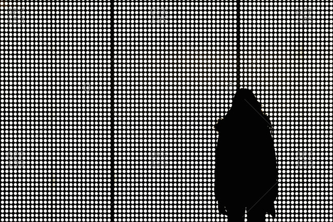 Silhouette of person against spotty background