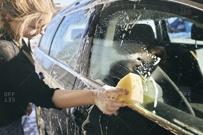 Woman cleaning car