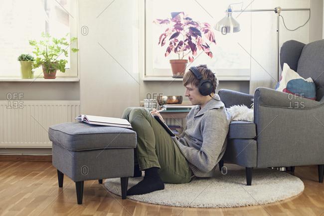 Man listening music in living room