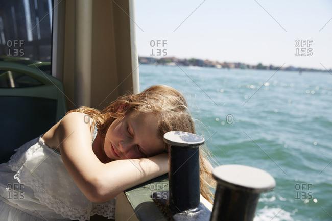 Girl sleeping on boat
