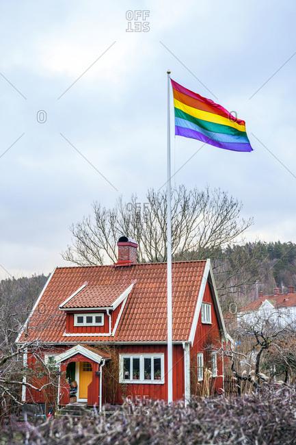 Rainbow flag near wooden house