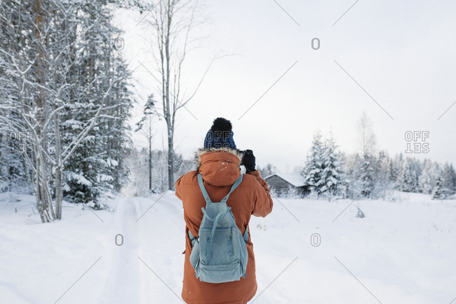 Young woman hiking in winter