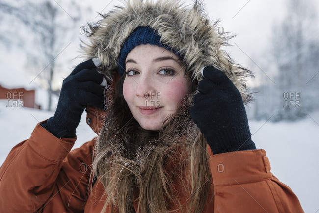 Portrait of young woman hiking in winter