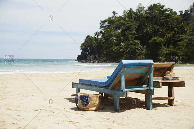 Empty lounge chairs on beach