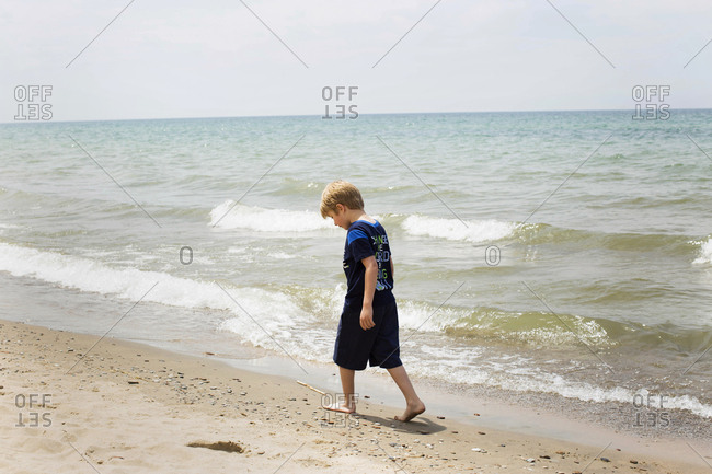 Child walking alone on the beach