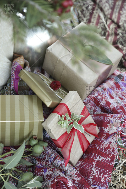 Christmas presents decorated with natural leaves and flowers