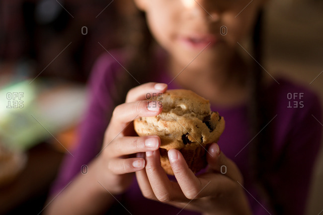 Girl holding a muffin