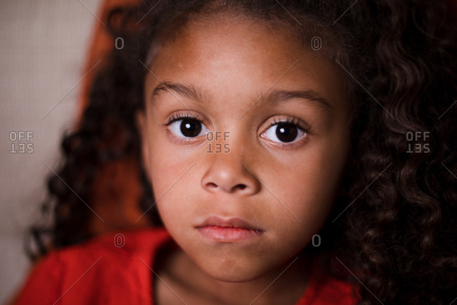 Portrait of a little girl with big brown eyes