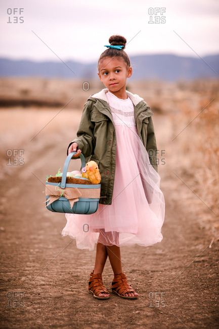 Pretty little girl holding Easter basket