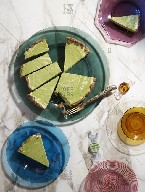 Party spread of lime pies on multicolored plastic dishes