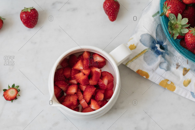 Top view of bowl filled with chopped strawberries