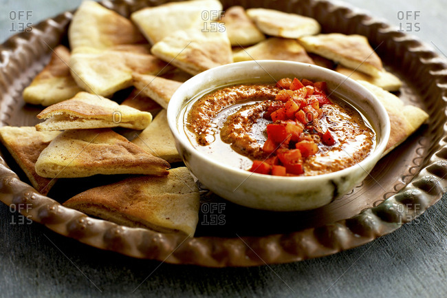 Roasted red pepper harissa pesto served with pita chips