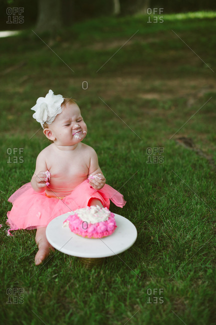 Baby girl with smash cake on her first birthday