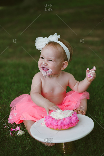 Baby with smash cake on her first birthday
