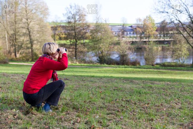 Senior woman looking through binoculars