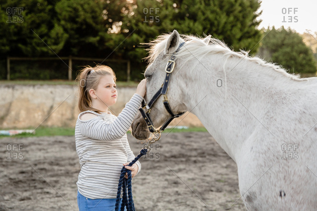 Girl petting horse - Offset Collection