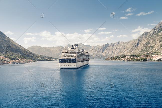 Bay of Kotor, Montenegro - June 25, 2015: Cruise ship sailing in sea against mountains