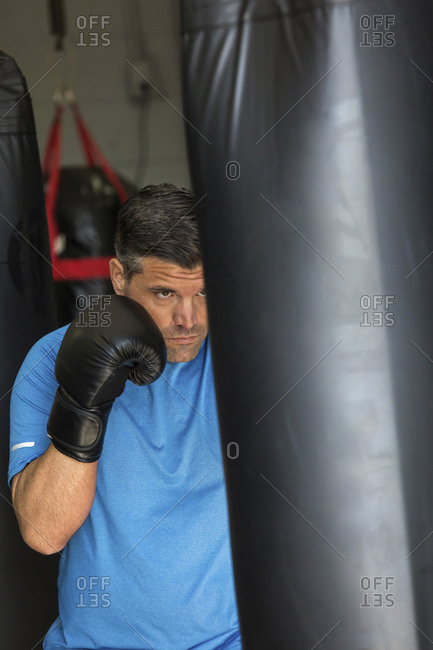 Male boxer practicing in gym