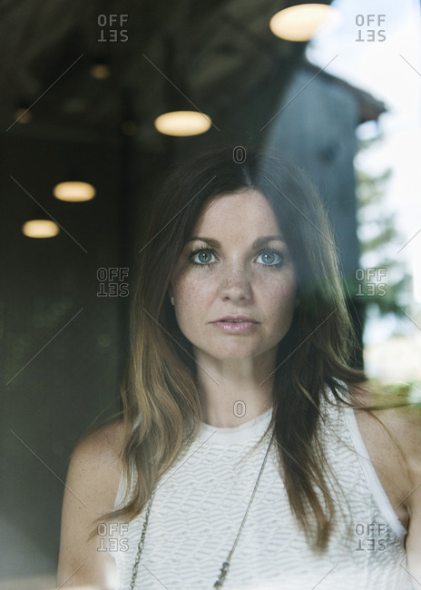 Portrait of woman seen through window