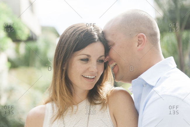 Close-up of happy couple romancing while standing outdoors