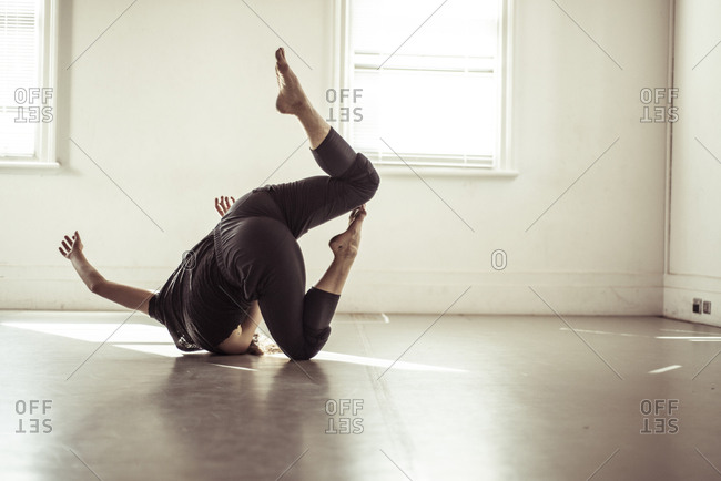 Woman dancing on floor in studio