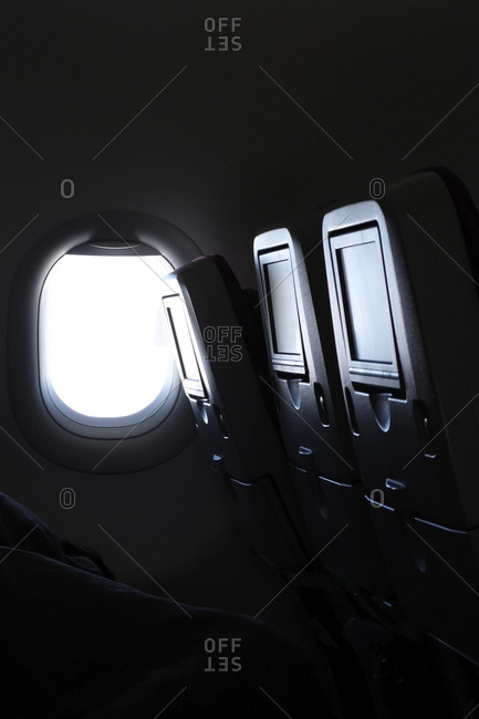 Airplane window and vehicle seats during flight
