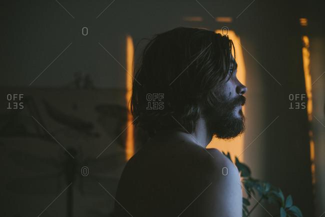 Profile of shirtless young man